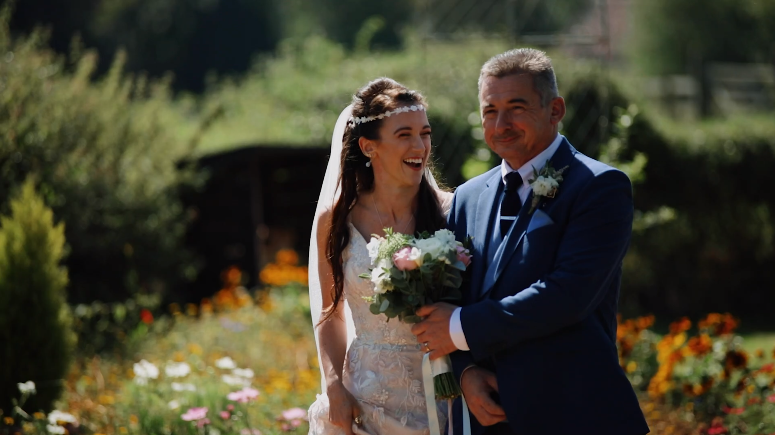 Ashleigh and her dad walking up the woodland aisle at the wroxeter hotel, shrewsbury